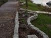 Kamień murowy z granitu, szary, średnie ziarno, łupany i otoczony