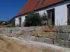 Granit-Mauersteine / Naturstein-Mauer / Granit-Mauer / Wasserbausteine, grau-gelb, Mittelkorn, gespalten (Granit-Mauersteine aus Polen), Mauersteine für eine Natursteinmauer, Polengranit - Foto von unseren Kunden