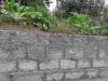Kamień murowy z granitu, szary, średnie ziarno, cięto-łupany