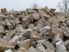 Unregelmäßige Mauersteine aus Sandstein (Sandstein-Mauersteine), die von unserer Kundschaft auch für ein Zyklopenmauerwerk bestellt werden (Sandstein-Mauersteine aus Polen)