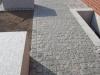 Inwestycje realizowane z wykorzystaniem kostki granitowej - na zdjęciu kostka granitowa, szara, łupana (polski mrozoodporny granit)