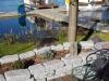 """Referenzobjekt… Kundenfoto… getrommelte, veraltete, """"antik"""" Granit-Mauersteine / Naturstein-Mauer ohne scharfe Kanten… (Granit-Mauersteine aus Polen), Mauersteine für eine Natursteinmauer, Polengranit"""