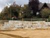 Kamień murowy z granitu, szaro-rudy, średnie ziarno, łupany